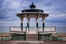 Beautiful View Of The Wooden Pier Over The Sea In Brighton Bandstand, UK