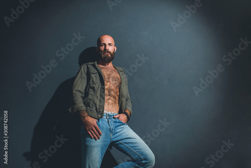 Portrait of a brutal bearded man with a naked torso. Tablou Canvas