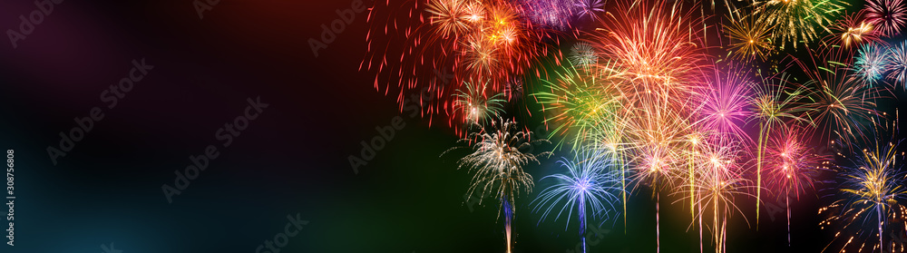 Fototapeta Colorful fireworks with wide dark copy space