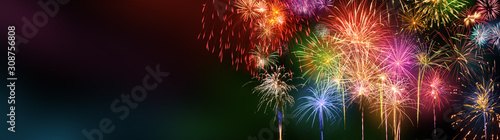 Colorful fireworks with wide dark copy space - 308756808