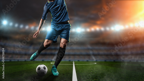 Fotografija Soccer player kicks the ball on the soccer field
