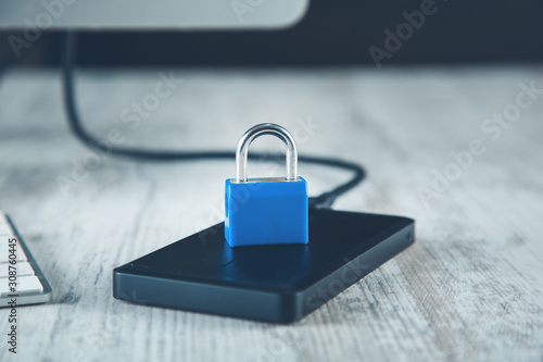 Fotomural  lock on HDD on the wooden desk