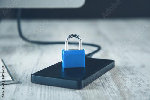 Obraz na plátně  lock on HDD on the wooden desk