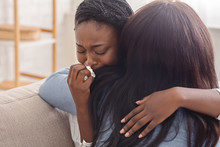 Woman Hugging Her Crying Girlfriend, Supporting Her After Receiving Bad News