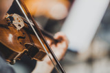 Side views of classical instruments - violin, double basses, cellos, closeup of hands