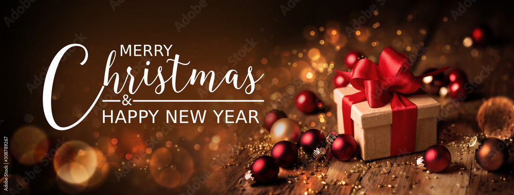 Christmas Card  -  Merry Christmas and happy new year  -  Gift box and ornaments on rustic wooden background with magic lights  -  Banner, header
