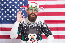 Just Perfect. Christmas Traditions And Observances Changed Greatly Over Time. American Bearded Hipster Guy Joined Cheerful Celebration. American Tradition. Santa Claus On American Flag. Winter Season