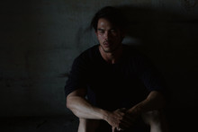 Depressed And Hopeless Asian Man Sitting Alone After Using Drugs Sitting On The Floor. Drugs Addiction And Withdrawal Symptoms Concept.