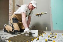 Tiler Installing Tile On Bathr...