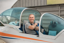 Elderly Man Learns To Drive A Light Airplane. Pilot Training Course. Flight On Light Aircraft
