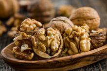 Handful Of Walnuts On Wooden B...