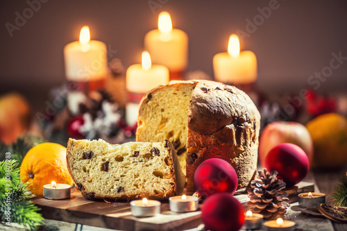 obraz dibond Delicious panettone on christmas table wit decorations and advent wreath and candles