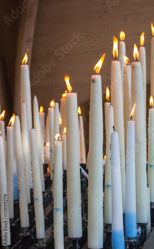 Платно 09/29/2019 - Lourdes, France: big burning candles from prayers for hope