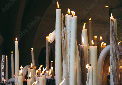 09/29/2019 - Lourdes, France: big burning candles from prayers for hope Canvas Print