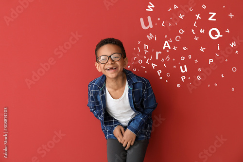 Laughing African-American boy on color background Canvas Print