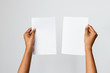 canvas print picture - Studio shot of an ethnic or black model holding an A5 or folded letter size blank mockup