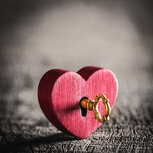 Small Rustic Red Heart With Shiny Golden Key On Wooden Table - Valentine's Day Concept
