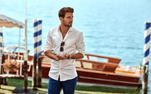 Handsome Young Man Wearing Elegant White Shirt And Standing Near Luxury Boat