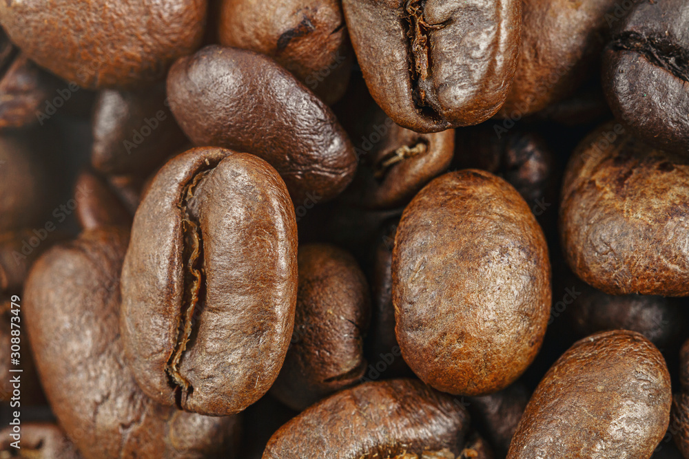 Roasted coffee beans closeup. Background texture.
