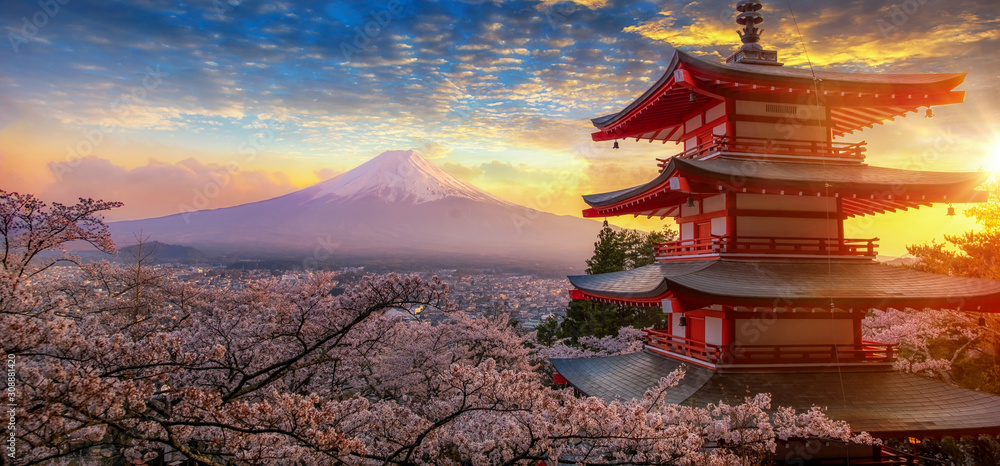 Fototapeta Fujiyoshida, Japan Beautiful view of mountain Fuji and Chureito pagoda at sunset, japan in the spring with cherry blossoms