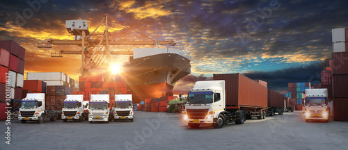 fototapeta na szkło Container truck in ship port for business Logistics and transportation of Container Cargo ship and Cargo plane with working crane bridge in shipyard at sunrise, logistic import export and transport in