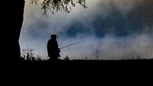 Fisherman At Lake In Morning Haze