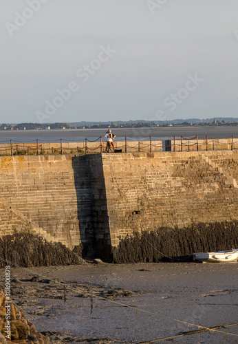 Photo Accordionist on the breakwater in Cancale, Brittany, France