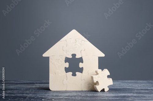 Puzzle house with a missing piece Fototapet