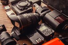Photo Equipment Digital Camera, Flash Lighting, Flash Trigger, LED, Memory Card CF SD MicroSD, Lenses, Tripod, Battery For Hobby Travel Photography Creative Designer, Technology Development Concept.