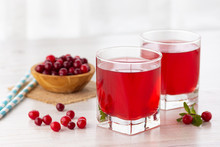 Glass With Fresh Organic Cranberry Juice And Red Cranberries.