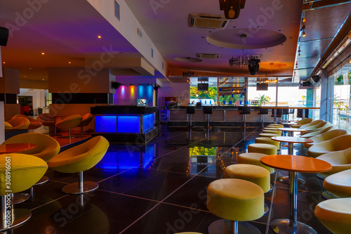 lounge bar of modern European resort hotel, interior with terrace, tables, lighting фототапет