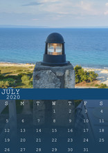 July 2020 Calendar With A Blue Outdoor Lamp With Sea And Beach Background. In Size A3