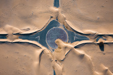 Aerial View Of Roundabout In Desert