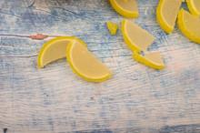 Marmalade Lemon Slices On Wooden Background. Sweet Dessert. Close Up.