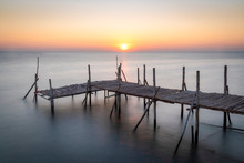 Old Wooden Bridge At Sea In The Morning