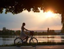 Happy Woman Riding A Retro Bik...