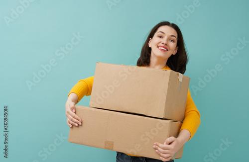 woman is holding cardboard box Canvas Print