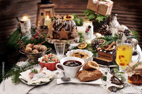 Fototapeta Christmas Eve table with traditional dishes and cakes obraz