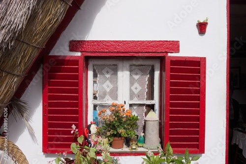 Isolated red window with plants and decorations of a traditional house in Santan Canvas Print