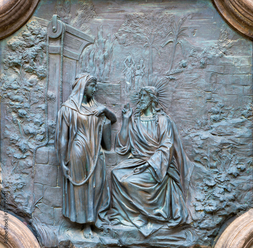 ACIREALE, ITALY - APRIL 11, 2018: The bronze relief of Jesus with the Samaritan woman at the well from the gate of Basilica Collegiata di San Sebastiano probably from 19 Wallpaper Mural