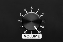 Volume Control Knob Of A Black Amplifier On Maxiumum Loudness