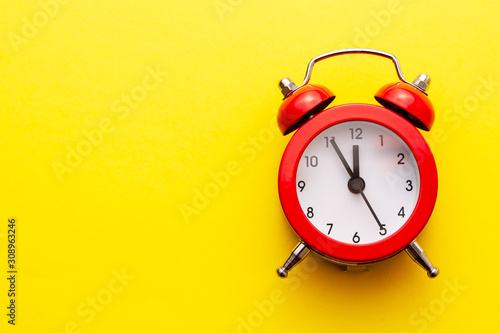 Obraz Colorful red traditional alarm clock with bells - fototapety do salonu