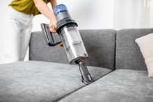 Woman Cleaning Sofa With A Mod...