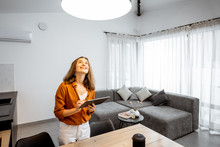 Young Woman Controlling Home L...