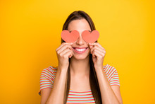 Closeup Photo Of Funny Lady Holding Hands Little Red Paper Hearts Shy Person Hiding Eyes Flirty Girlish Mood Wear Casual Striped T-shirt Isolated Yellow Color Background