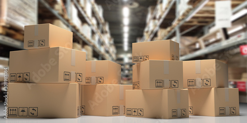 Vászonkép Cardboard boxes on blur storage warehouse shelves background