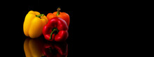 Yellow, Red And Orange Pepper Paprika On A Black Background, Panoramic Image