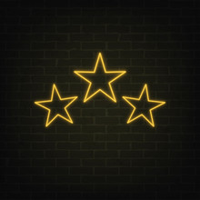 Vector Poster Of 3 Neon Light Stars On Grunge Brick Wall Background. Shining Yellow Symbols In Retro Style. Glowing Stars Banner For Rating Cards, Templates And Your Own Projects. EPS 10 File.