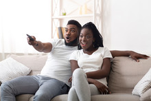 Excited Afro Couple Watching T...
