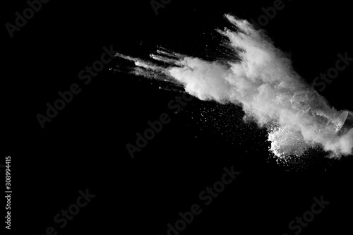 Obraz White talcume powder explosion on black background. White dust particles splash. - fototapety do salonu